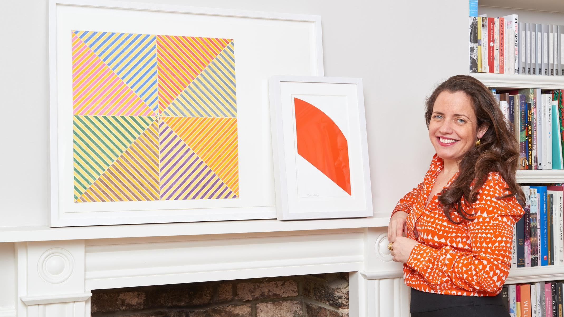 Lyndsey Ingram standing in front of a painting