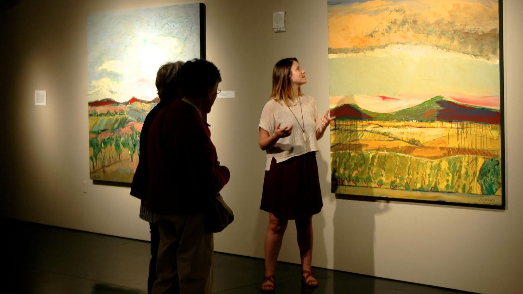 McKenzie Conner working as a docent in a gallery