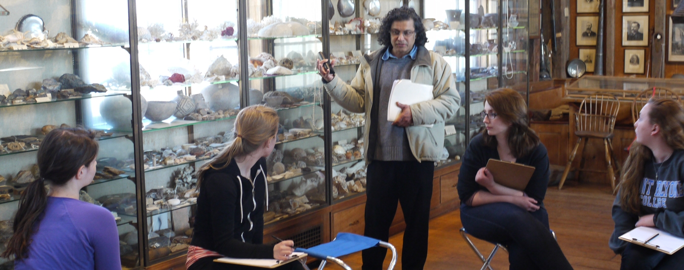 Professor Ajay Sinha teaches a class in the Skinner Museum