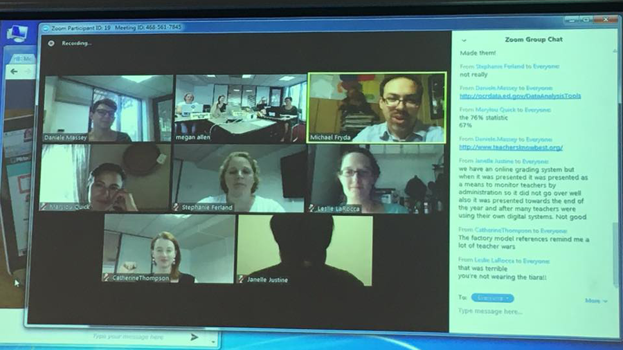 Photo of a computer screen with seven windows showing participants in an online panel discussion