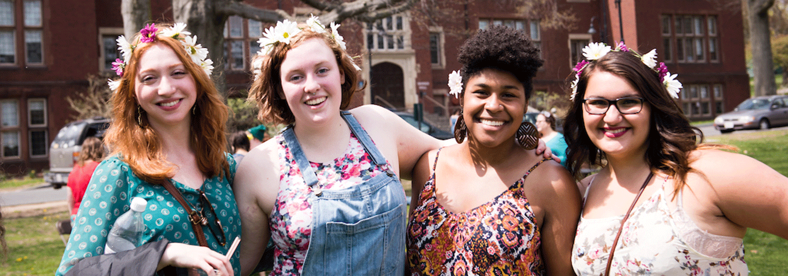 Photo of a group of students celebrating Pangy Day with flowers in their hair