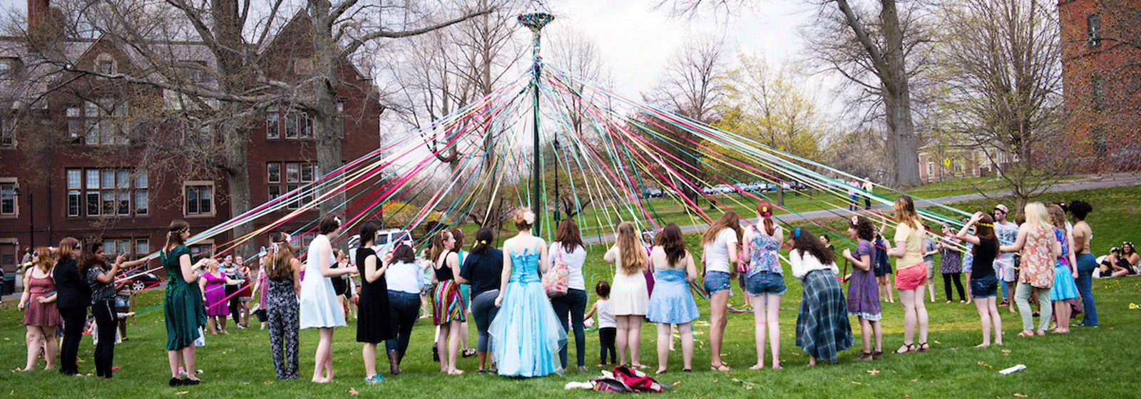 Photo of students dancing around the maypole