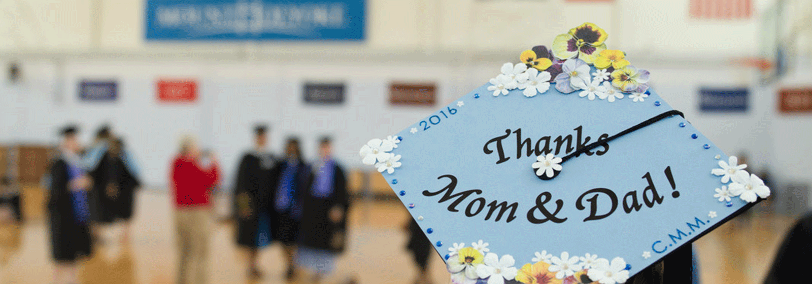 Image of graduate with thanks written on mortar board