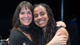 Suzan-Lori Parks and Leah Glasser embrace at the Gish Prize ceremony.