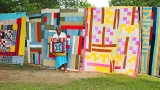 Mary Lee Bendolph, Gee's Bend quilter, with some of her artwork