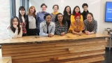 The reception desk designed and built by students (pictured left with Professor Naomi Darling, front right) in the design-build class held in the Fimbel Lab.