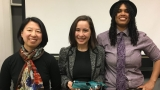 Erin Mullin, flanked by Jessica Sidman (l) and Maker Space coordinator Shani Mensing '15 (r)