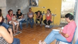 a group of young mothers gather inside the community center in Managua, Nicaragua