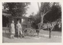 Two Mount Holyoke College students, farmerettes (WWI farming effort), with horse-drawn wagon delivering milk.