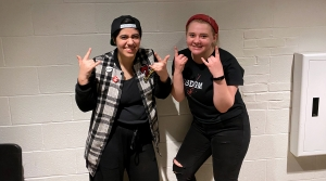 "First-year student Gina Pasciuto (left) and sophomore Hannah Dubé (right) take a break from all-day rehearsals for the musical ""American Idiot."""