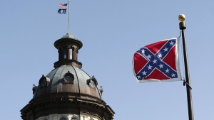 A Confederate flag flies near a confederate memorial in front of the South Carolina State House. Photo by Reuters/Tami Chappell.