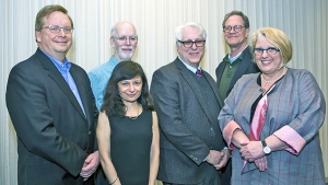 Dean of Faculty Jon Western (far left) and Acting President Sonya Stephens (far right) present the Faculty Awards to (from left) Douglas Amy and Kavita Khory (politics), Peter Scotto (Russian) and Michael Davis (art history).