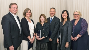 This is a photo of the awardees standing with Dean of Faculty Jon Western and Acting President Sonya Stephens.