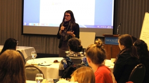 Meghan Godorov, associate director for alumnae and community engagement,  presents at the salary negotiation workshop. Photo by Ebru Kardan