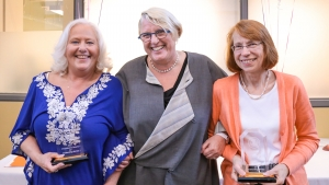 Acting President Sonya Stephens with staff award winners Linda Fernandes (left) and Joanne Picard (right) holding their trophies.