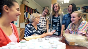 Darby Dyar, Kennedy-Schelkunoff Professor of Astronomy, working with students in her lab