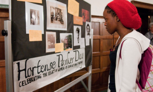 Student looks at a display at a previous Hortense Parker Day