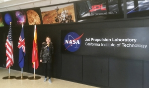 Sara Schnadt '92 standing in front of a NASA sign