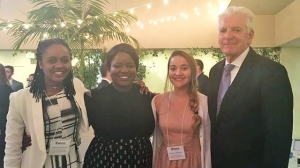Mount Holyoke's winning team at the IBECC event in Santa Monica: from left, Shanae McDonald '17, Pearl Umoye '19 and Hadassa Mikalixen '18, with the competition's founding director, Thomas White.
