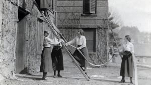 Students on a ladder during a 1920 fire drill.