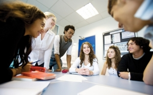Students interacting around a table
