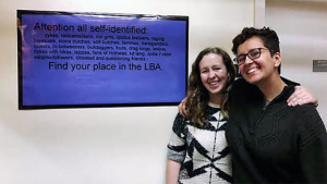 From left, Madeline Fitzgerald '21 with Chloe Jensen '20 at an Archives and Special Collections exhibit that Jensen created about the history of LGBT activism at Mount Holyoke