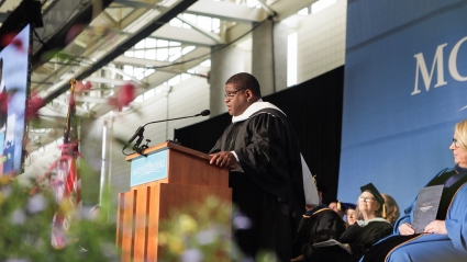 Gary Younge, on stage at Commencement 2019