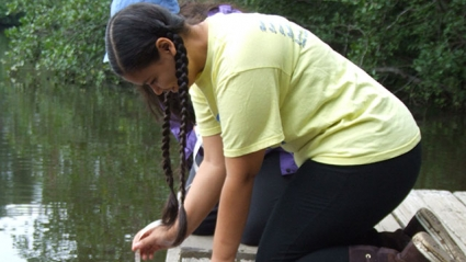 Jailene Rodriguez '20 gauges water transparency during the Restoration Ecology Summer Scholars Program in 2014.