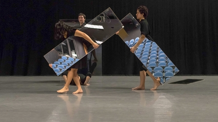 """Three student performers hold full-length mirrors in front of themselves as they rehearse Joan Jonas '58's """"Mirror Piece I & II: Reconfigured (1969/2018-2019)"""" under the guidance of the artist."""