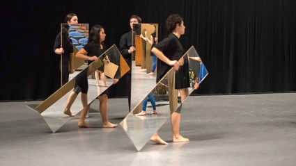 "Four student performers hold full-length mirrors in front of themselves as they rehearse Joan Jonas '58's ""Mirror Piece I & II: Reconfigured (1969/2018-2019)"" under the guidance of the artist."
