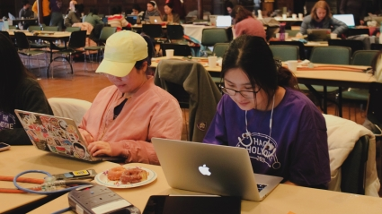 HackHolyoke 2019: Kiki Wang '21 (left) and Wenyun Wang '20 working on their game about the periodic table of elements.
