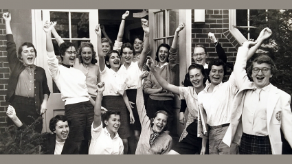 Students cheer with raised hands on Mountain Day, circa 1955