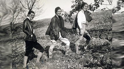 Three students hiking up the hill on Mountain Day 1930
