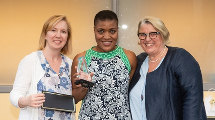Latrina Denson (center), associate dean of students, received the Mary Lyon Leadership Award from Heidi Friedman (left), director of human resources, and Acting President and President-elect Sonya Stephens (right).
