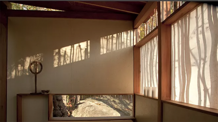 This is a view of part of the tea house that won Darling the AIA award in 2013. Vertical shadows play across semitransparent windows, weaving into wood patterns in the inetrior.