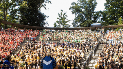 Convocation 2018: President Sonya Stephens addresses a sea of students in their class colors at the Gettell Amphitheater