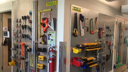 An organized wall of handtools in the Fimbel Lab