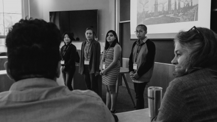 four student presenters listening to a question at LEAP 2018.JPG