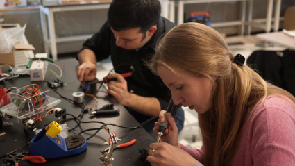 Photo of a student using the soldering station