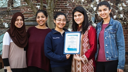 Members of Kuch Karo: Pakistani Students For Change, pose with their Distinguished Student Organization Award.