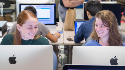 Two Mount Holyoke students working in a computer lab