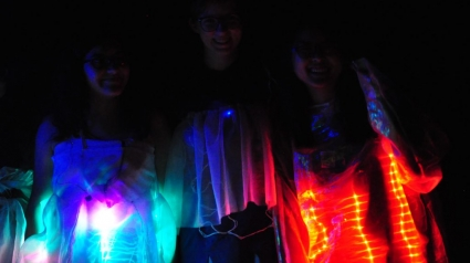 Photo of glowing costumes in the production Underwater Community