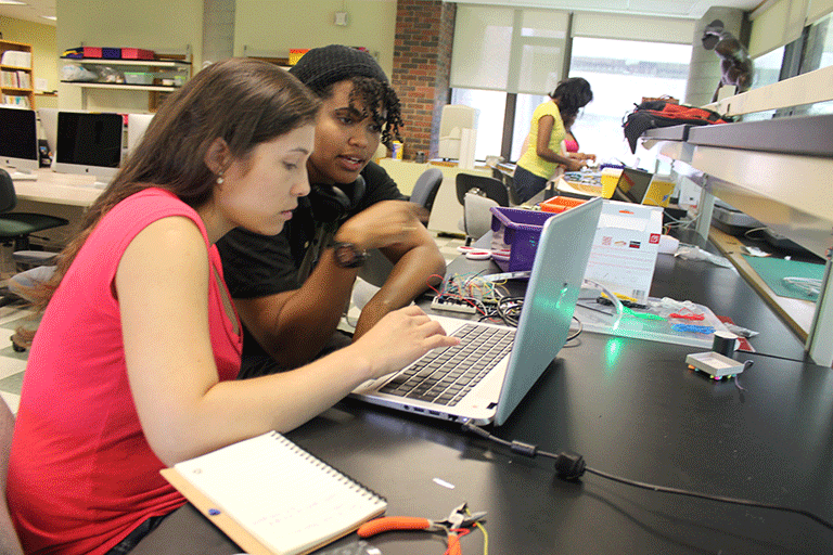 Photo of the Makerspace Coordinator working with a student