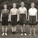 This is a 1933 photograph of four Mount Holyoke athletes in bloomers and short-sleeved blouses.