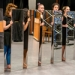 "Seven student performers hold full-length mirrors in front of themselves as they rehearse Joan Jonas '58's ""Mirror Piece I & II: Reconfigured (1969/2018-2019)"" under the guidance of the artist."