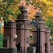 MHC Gates in the fall, surrounded by colorful leaves.