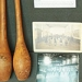 This is a photograph of historical athletics equipment, including Indian clubs (left).