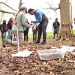 Kate Ballantine with a group of students examining a soil sample on the Project Stream site.