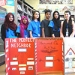 """This is a photograph of Iqbal with youth volunteers from her project, """"Be a Good Neighbor."""""""
