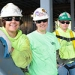This is a photograph of three women construction workers on the work site of the Community Center.